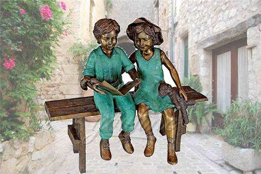 Life size outdoor sitting bronze children reading sculpture