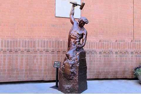 Bronze self made man statue