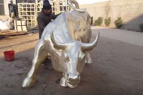 large bronze wall street bull statue outside on discount sale
