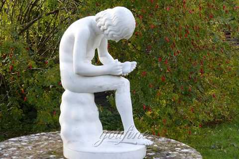Boy with thorn statue