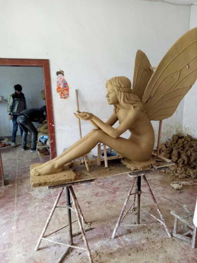 clay model of bronze angel girl statue