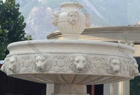 angel water fountain with lion head