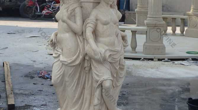 lady water fountain with lion head statue