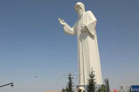 large white marble st charbel statue outside garden