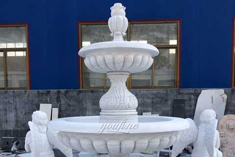 marble watre fountain with praying angel statues