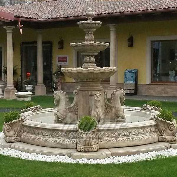 two yellow tiered marble fountain for sale