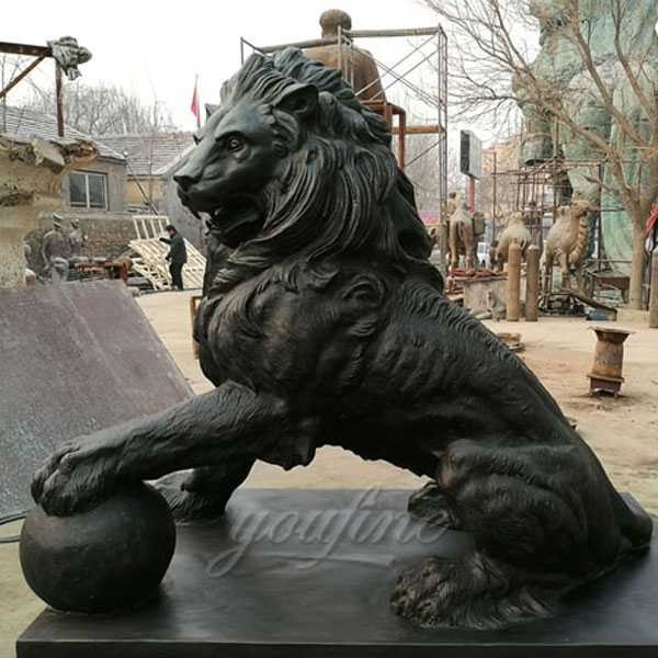 Outdoor bronze casting lion statues with ball in front of the zoo made for client from USA