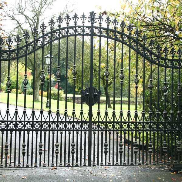 Inexpensive modern wrought iron garden driveway swing gates with solid frame design for sale--IOK-205