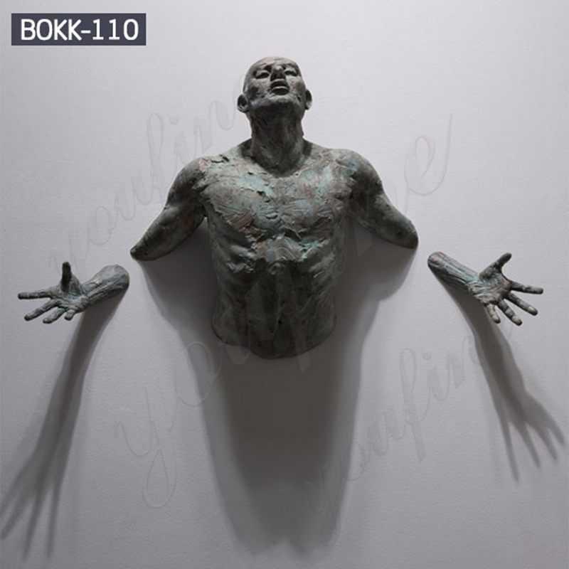 Contemporary-Bronze-Sculpture-Emerging-in-Walls-By-Matteo-Pugliese
