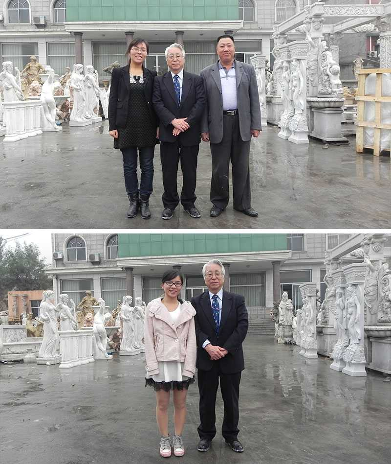 customer visiting factory for white marble statue
