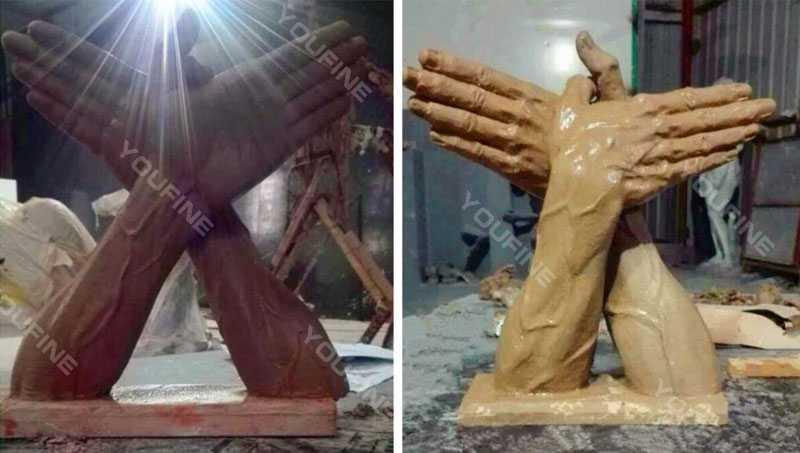 bronze butterfly hands sculpture statue