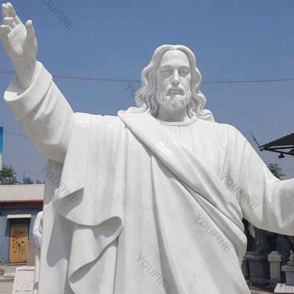 Outside Jaint catholic white marble church statues of christ Jesus making for parish garden