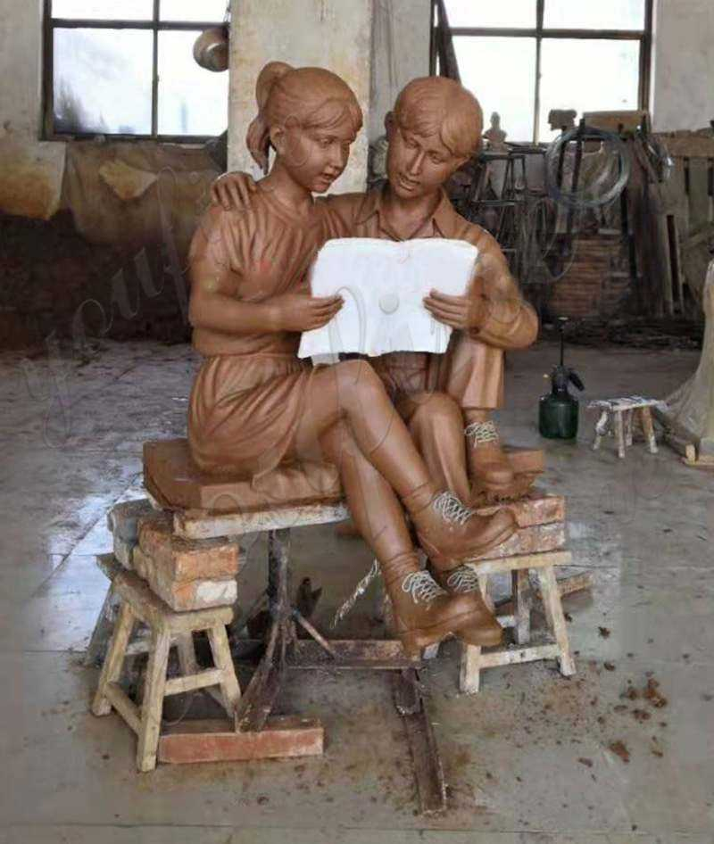 clay mold of Custom Made Kids Reading A book on Beach Bronze Statue