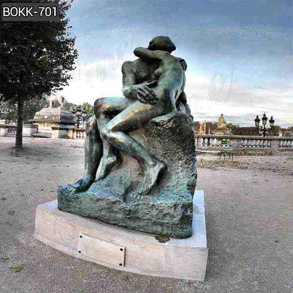 What is the Background of Auguste Rodin's the Kiss statue?