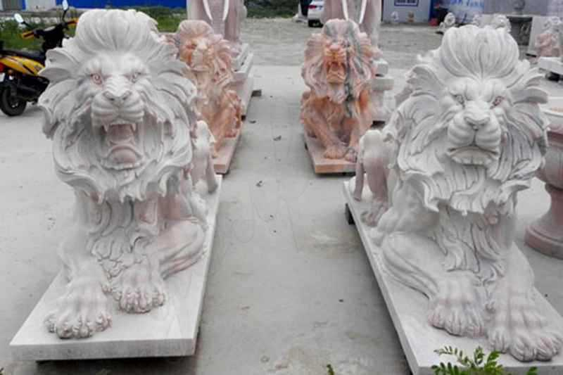 Life size entrance paired white marble lying and roaring lion statues