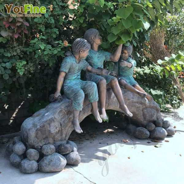 Bronze Statue of Children on Log with Butterflies