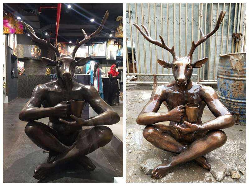 Bronze man statue with deer head