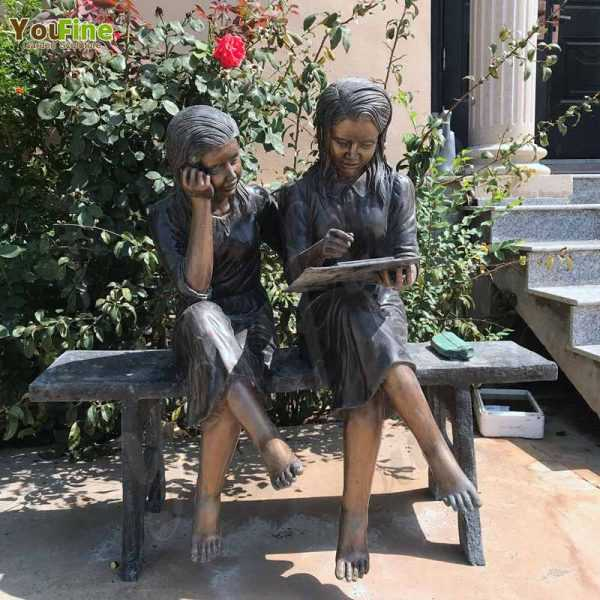 Lovely Bronze Sisters Reading Sculpture for Sale