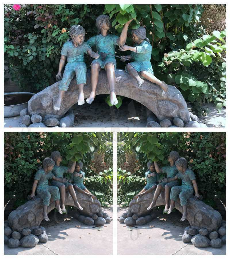 Statue of Children on Log with Butterflies