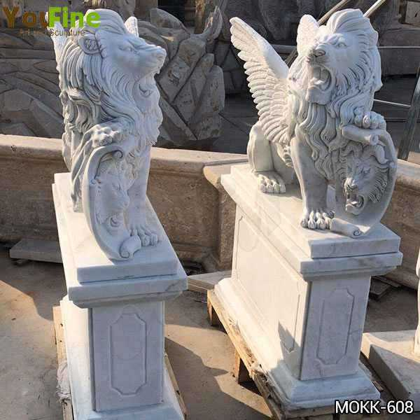 Antique Style White Marble Winged Lion Statues