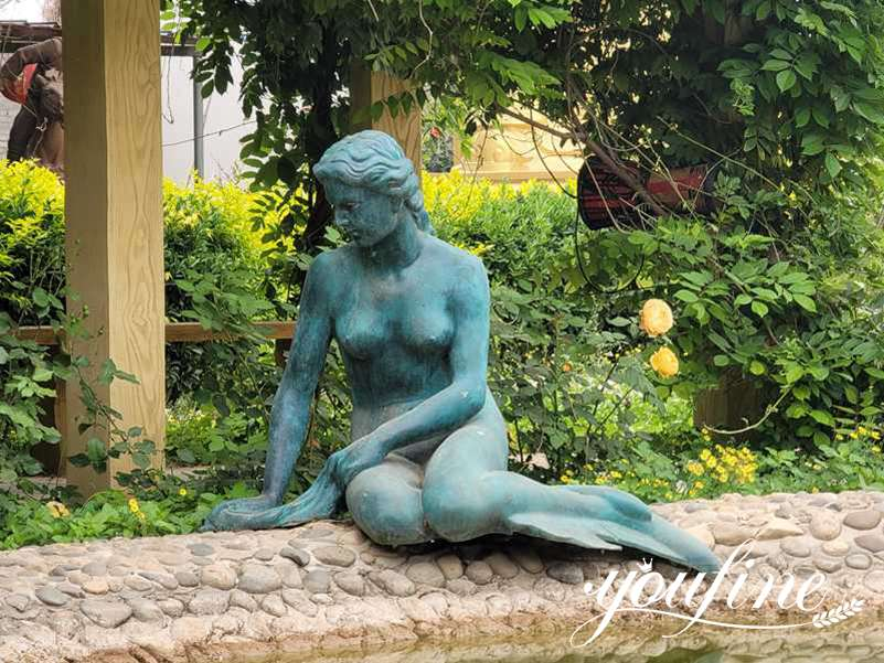 solid bronze mermaid statue